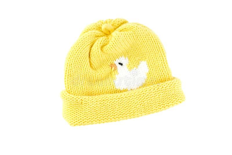 婴孩帽子编织黄色 库存图片