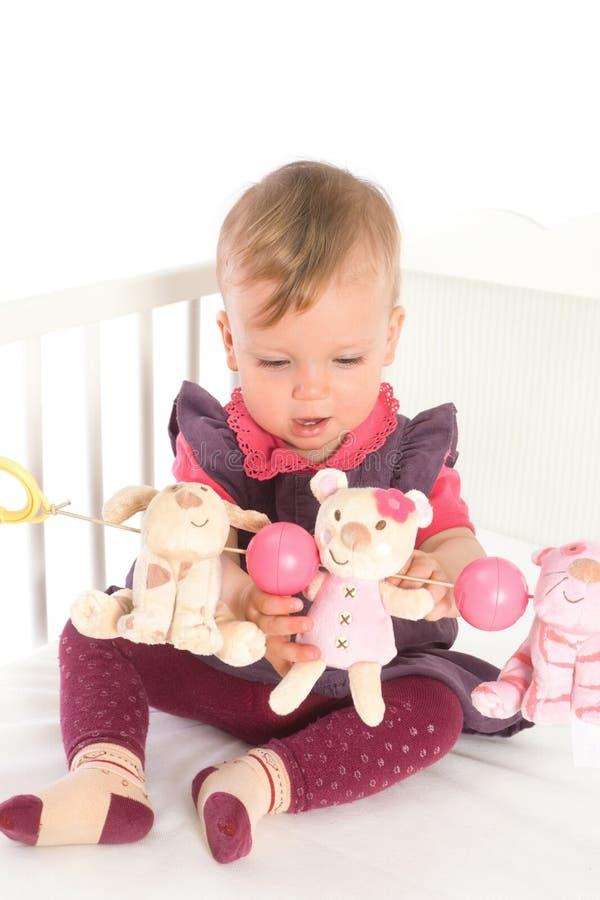 婴孩床女孩使用 免版税库存照片