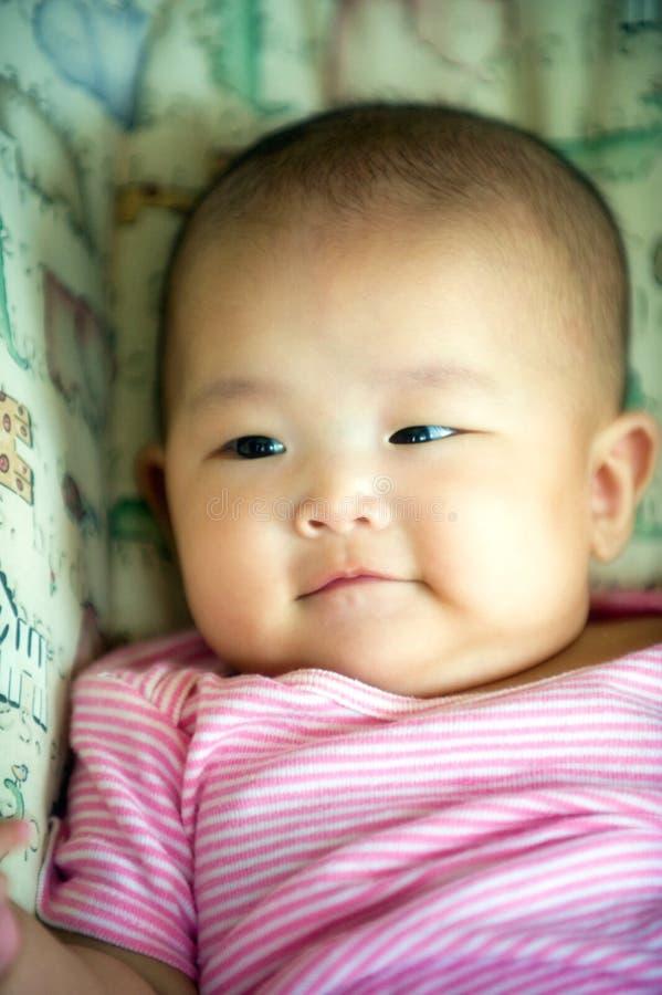 婴孩微笑的一点 免版税库存图片