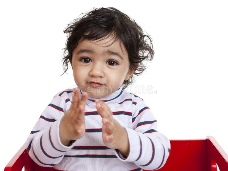 婴孩拍的女孩递愉快 库存图片