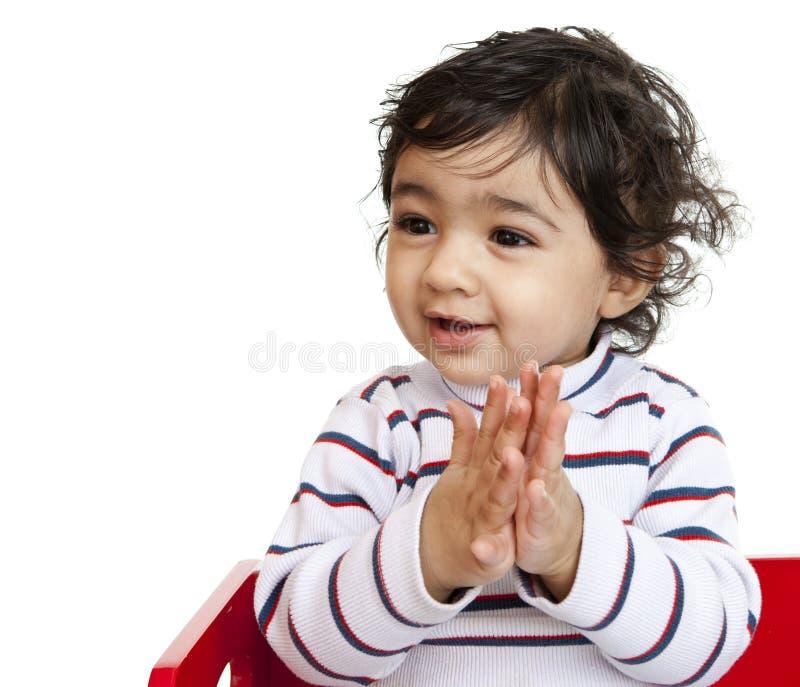 婴孩拍的女孩递愉快 免版税库存照片