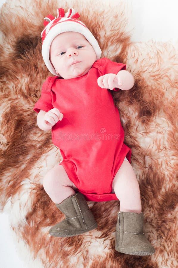 婴孩新出生chritstmas的帽子 免版税图库摄影