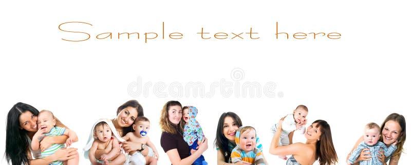 婴孩新她的集的妇女 免版税库存图片
