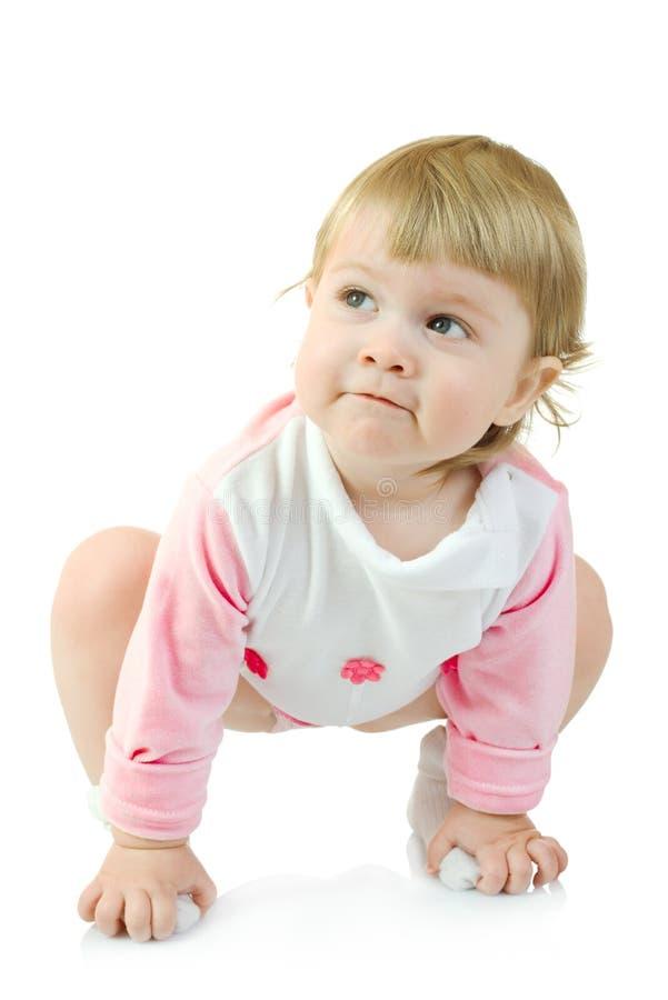 婴孩查出的执行体操使小 免版税库存照片