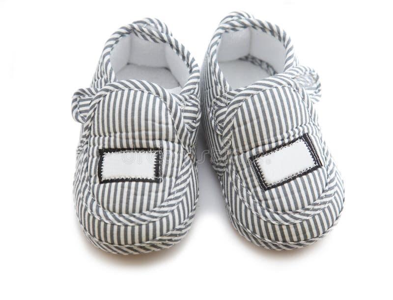 婴孩查出的鞋子 免版税图库摄影