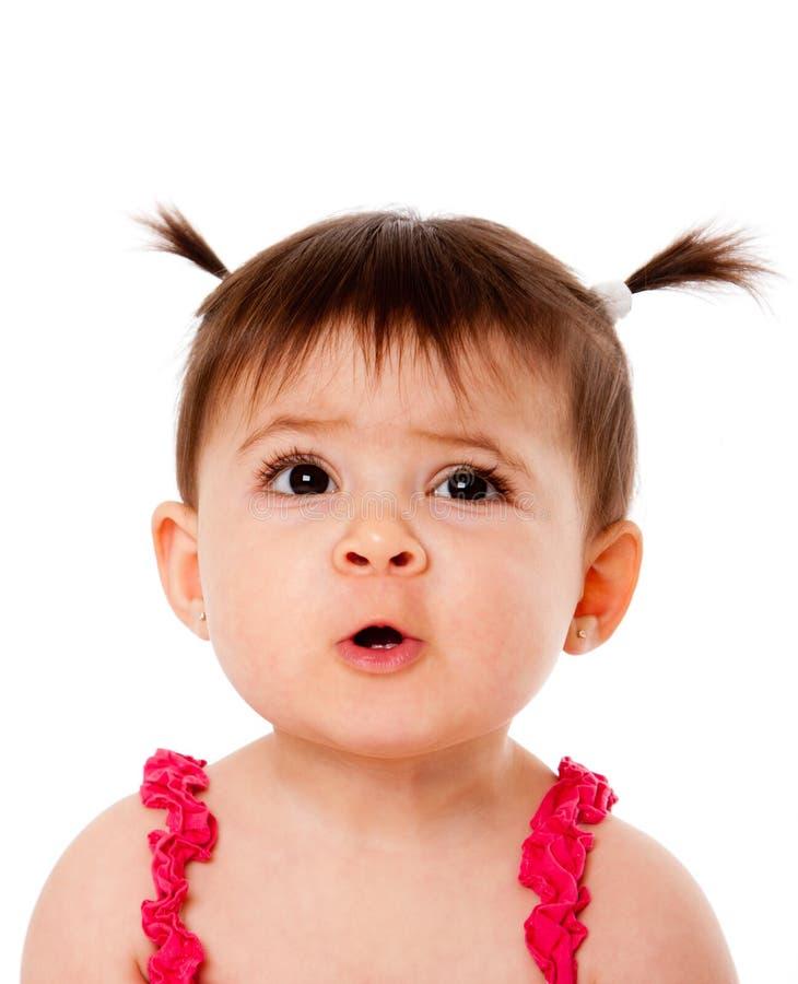 婴孩滑稽表达式的表面 库存照片