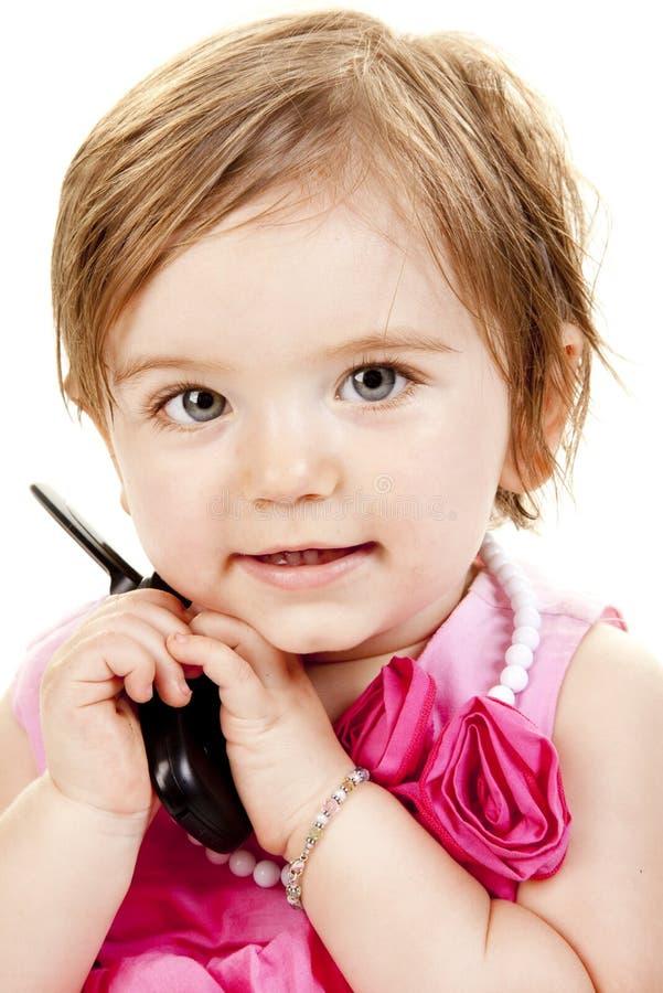 婴孩电池逗人喜爱的女孩藏品电话 免版税库存图片