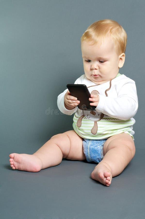 婴孩电话聪明texting 库存图片