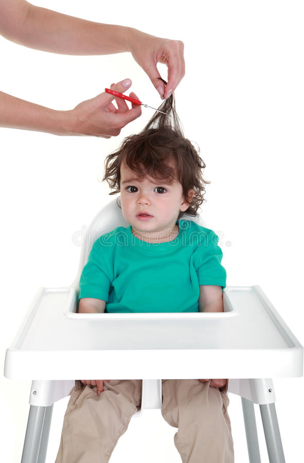 婴孩的第一理发 库存图片