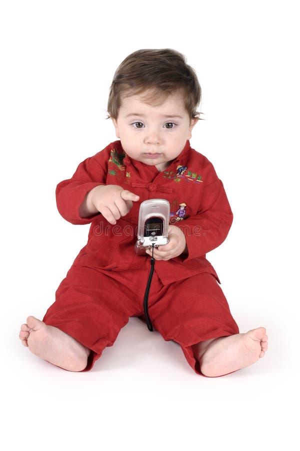婴孩移动电话联系 免版税库存照片