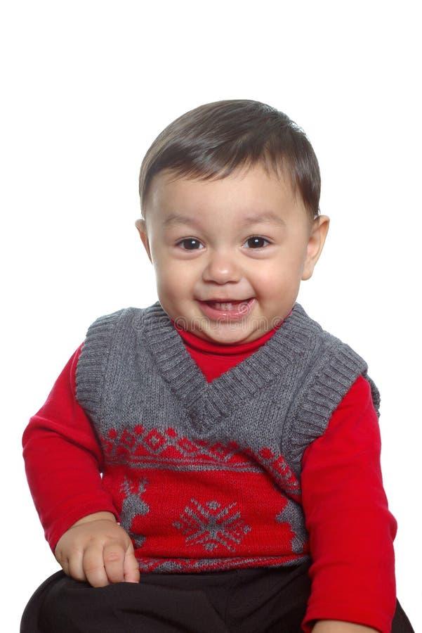 婴孩红色毛线衣佩带 免版税库存图片