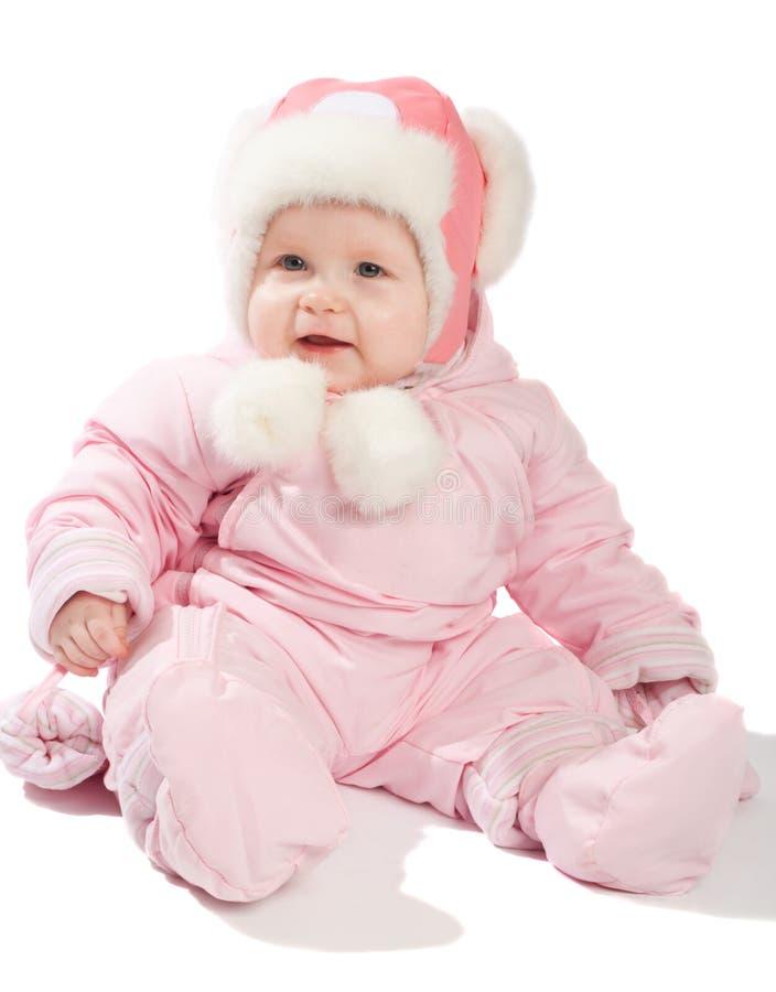 婴孩给桃红色冬天穿衣 免版税库存图片