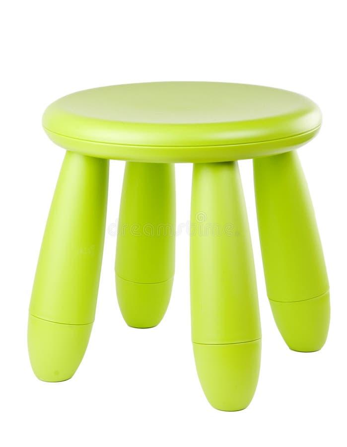 婴孩绿色塑料凳子 免版税库存图片