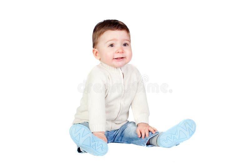 婴孩美丽的楼层坐 免版税库存照片