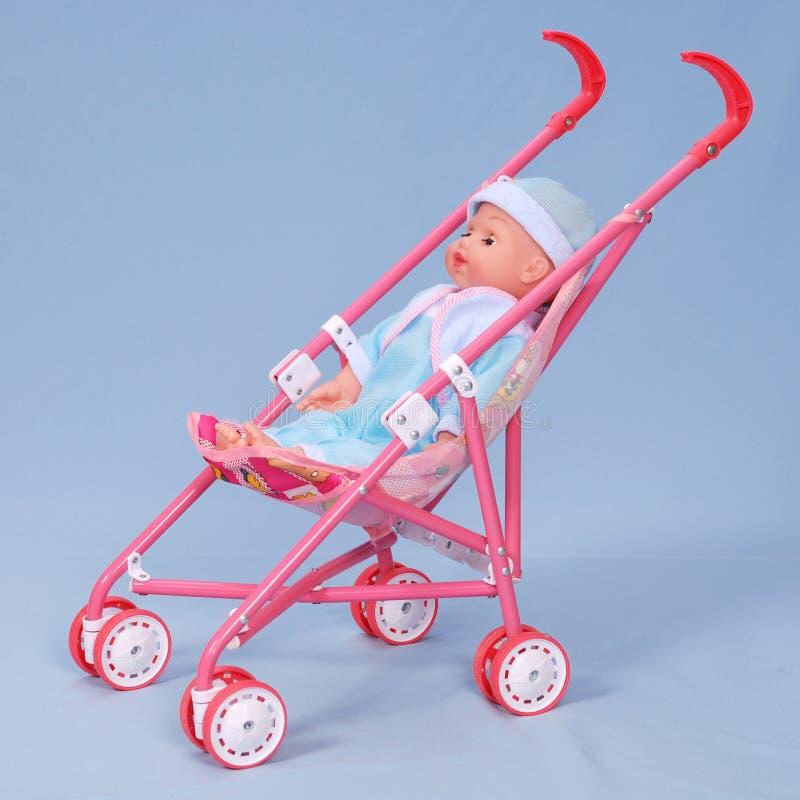 婴孩背景蓝色多虫的玩具 免版税库存图片