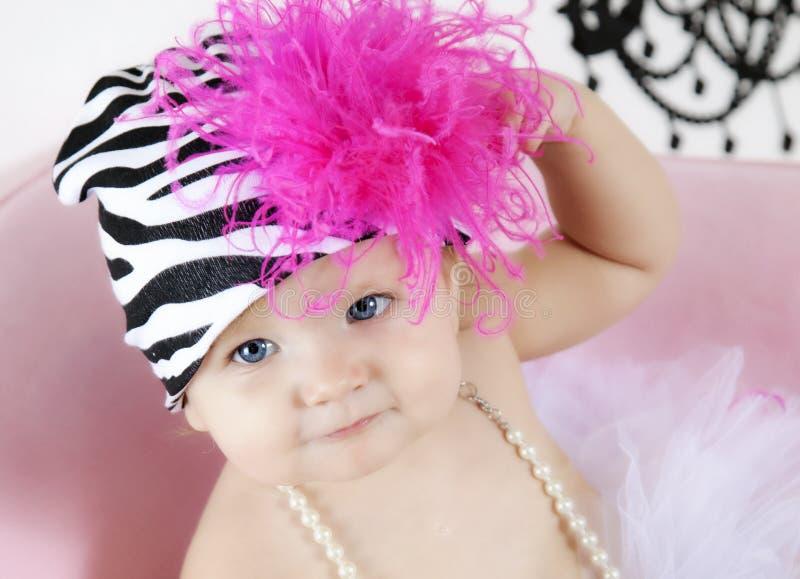 婴孩逗人喜爱的女孩帽子 免版税图库摄影