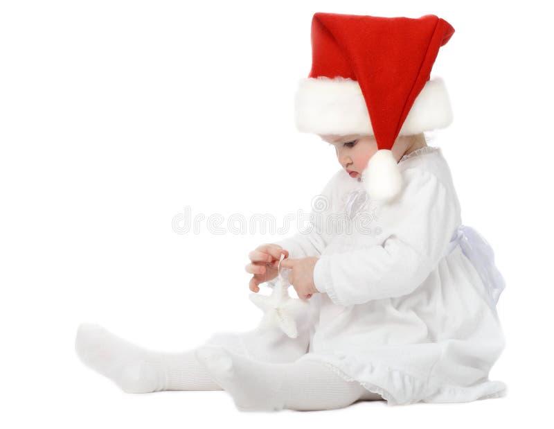婴孩逗人喜爱的帽子s圣诞老人 库存照片