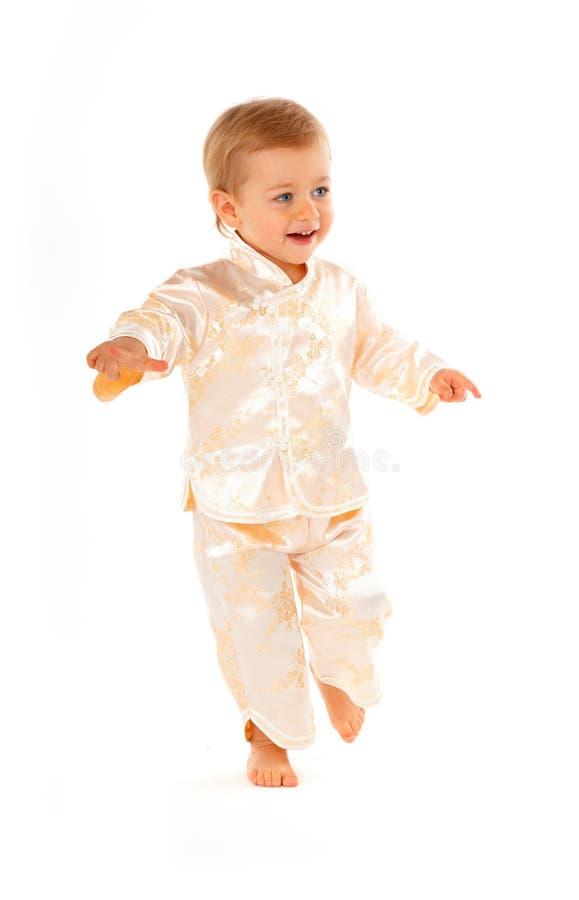 婴孩逗人喜爱的跳舞runnig 库存照片