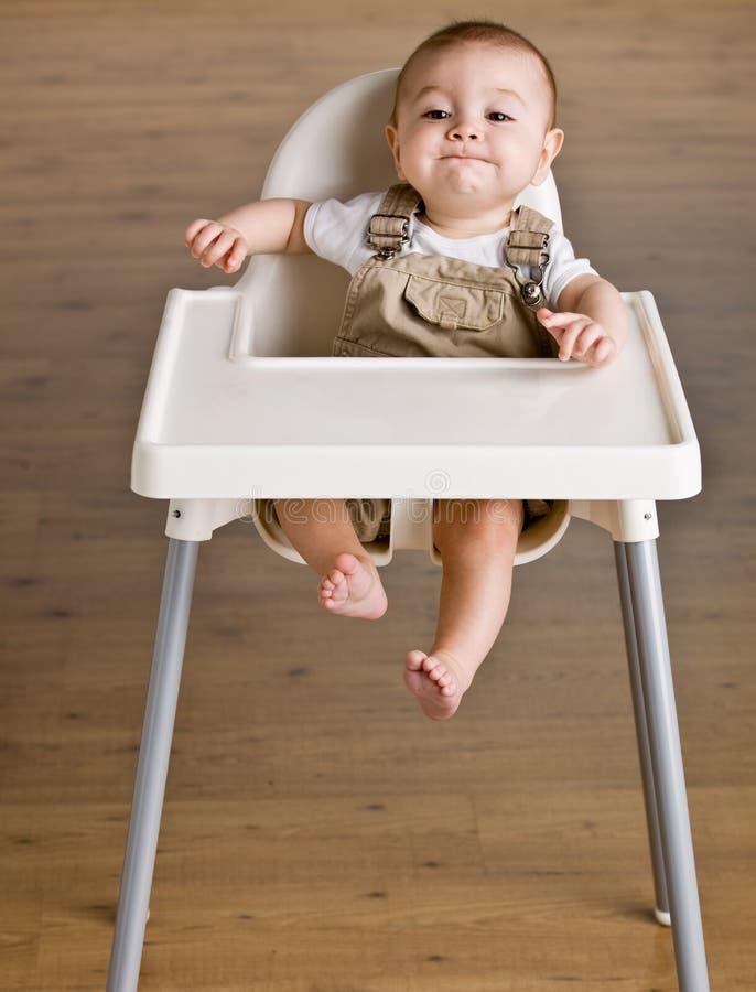 婴孩高脚椅子开会 免版税库存图片