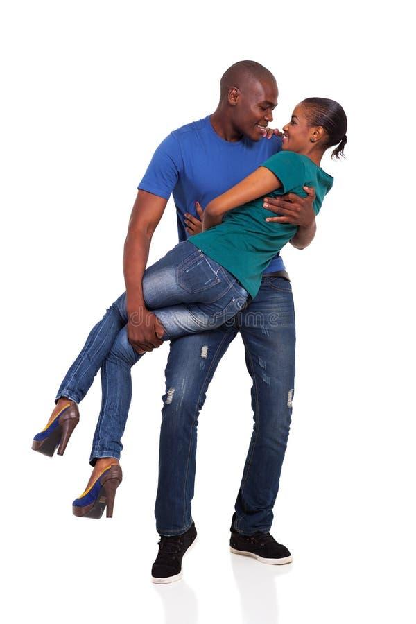嬉戏的非洲夫妇 免版税库存照片