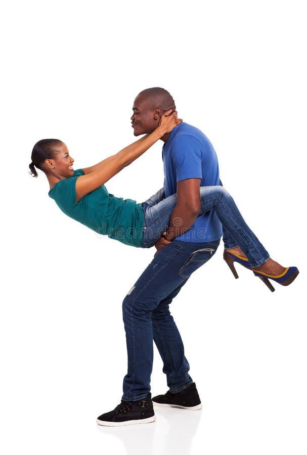 嬉戏的非洲夫妇 库存图片