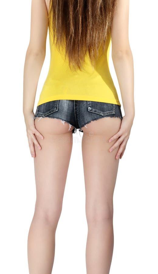 驴子妇女佩带短的牛仔裤短缺与黄色无袖衫 库存图片