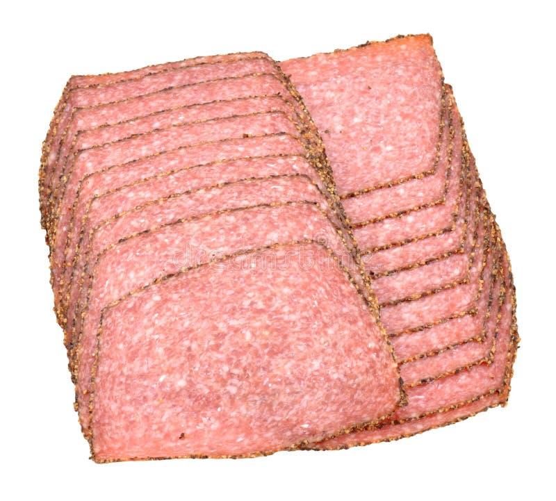 以子弹密击的蒜味咸腊肠肉切片 库存照片