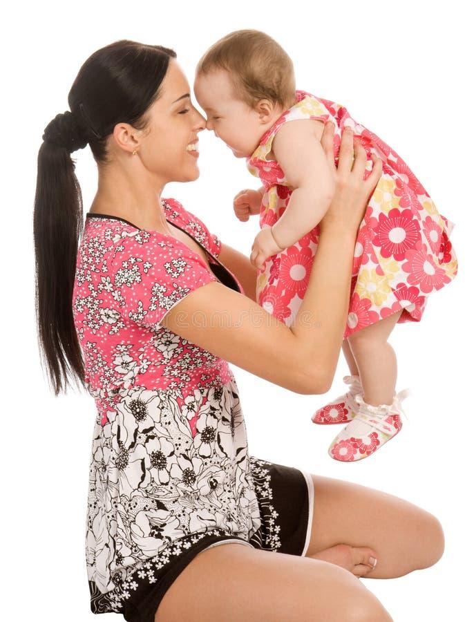 子项他的暂挂婴儿母亲 图库摄影