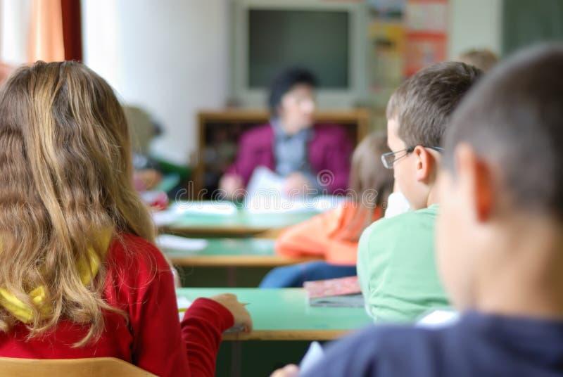子项在教室 免版税库存照片