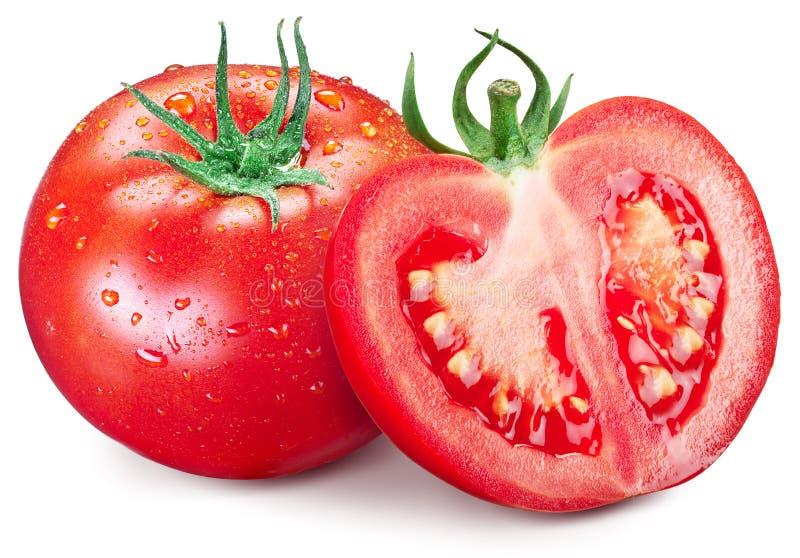 钻孔蕃茄和一半与水下落在他们 免版税库存图片