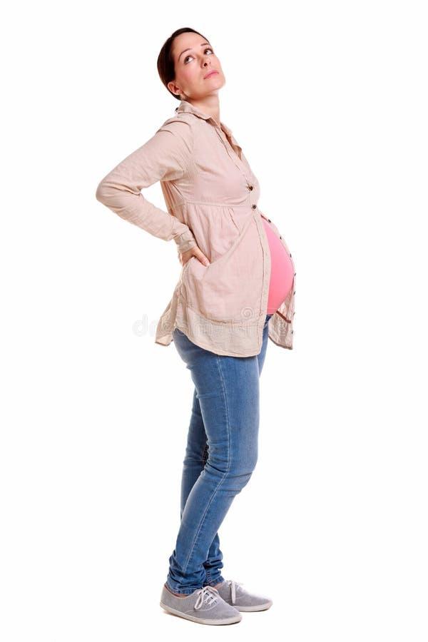 孕妇以腰疼。 免版税图库摄影