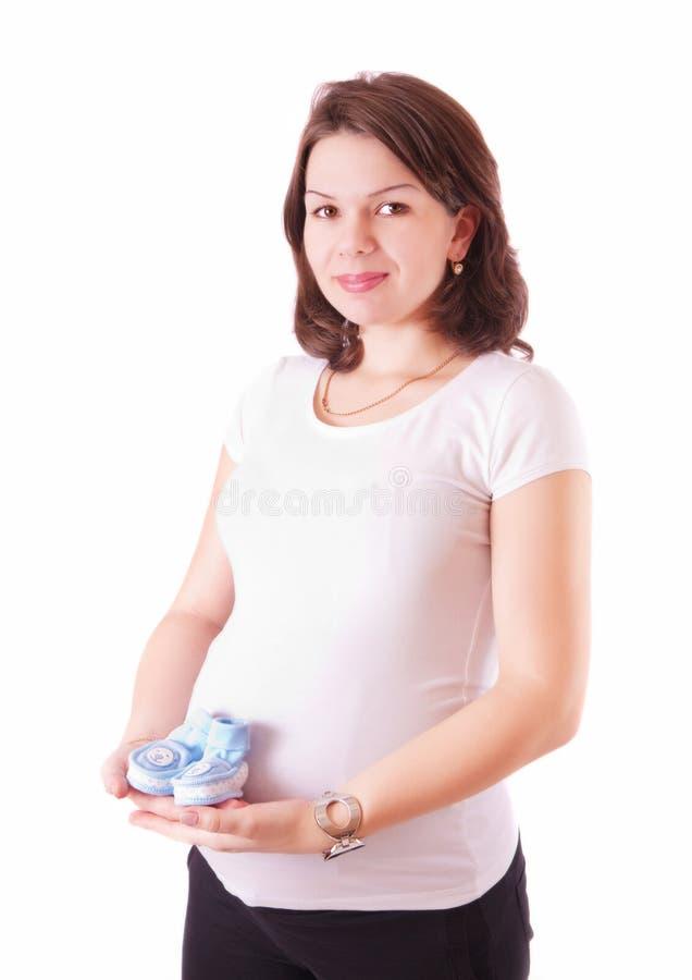 孕妇画象有童鞋的 免版税库存照片