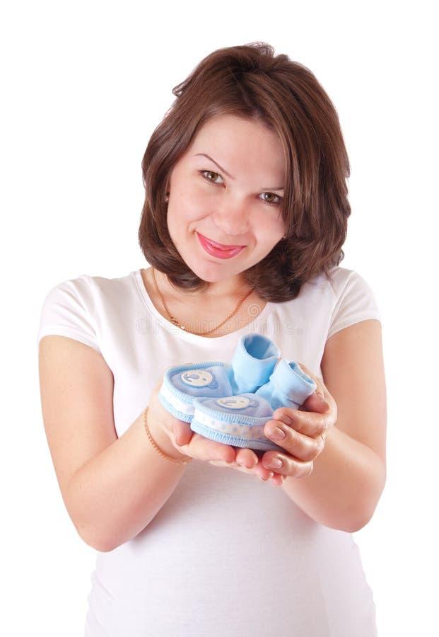 孕妇画象有童鞋的 免版税库存图片
