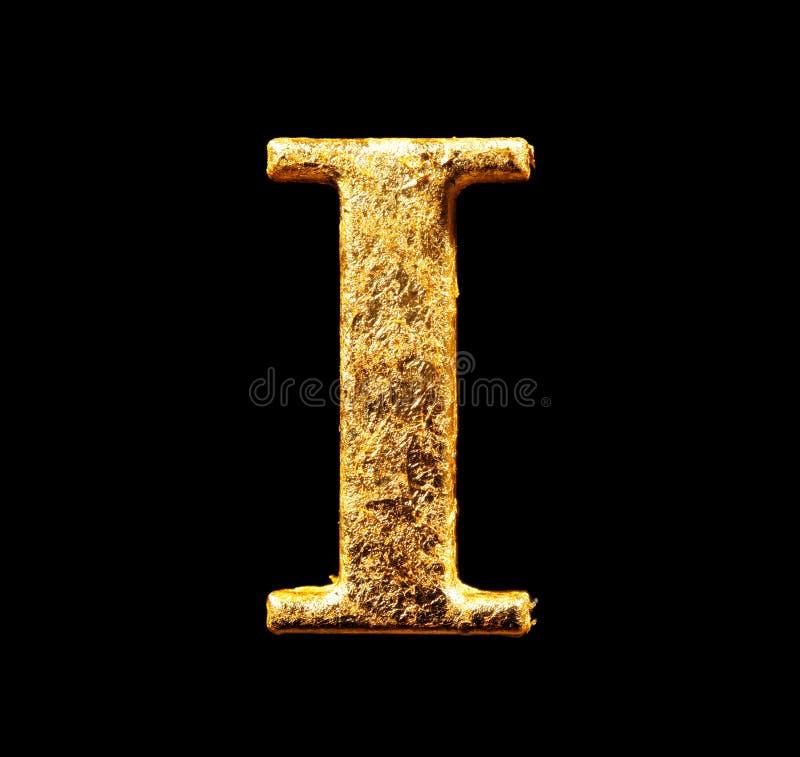 字母表和数字在金叶 免版税库存图片