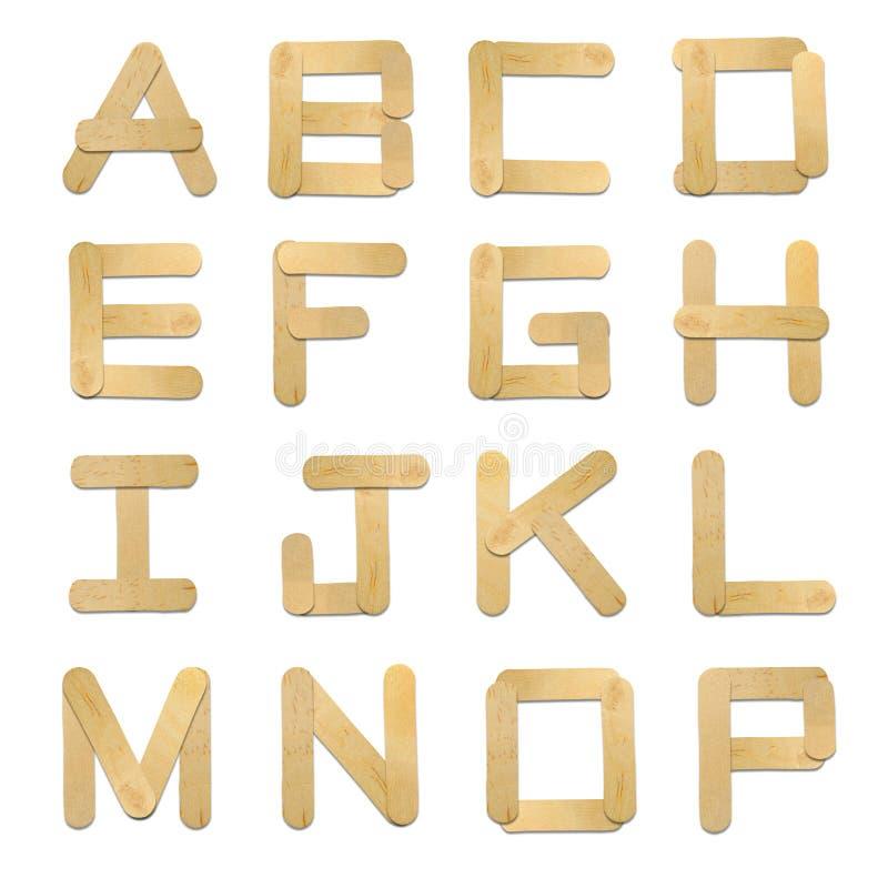 字母表奶油色冰棍子木头 库存照片