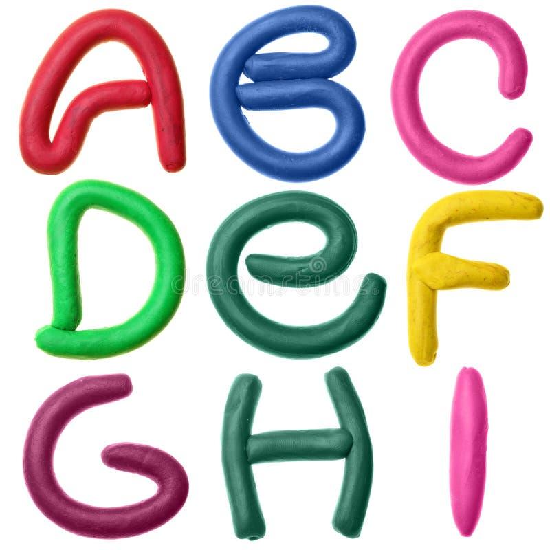 字母表彩色塑泥 库存图片