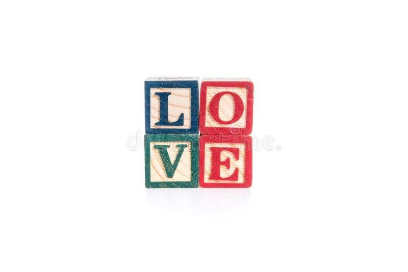 字母表的照片阻拦拼写在白色背景的爱孤立 库存照片