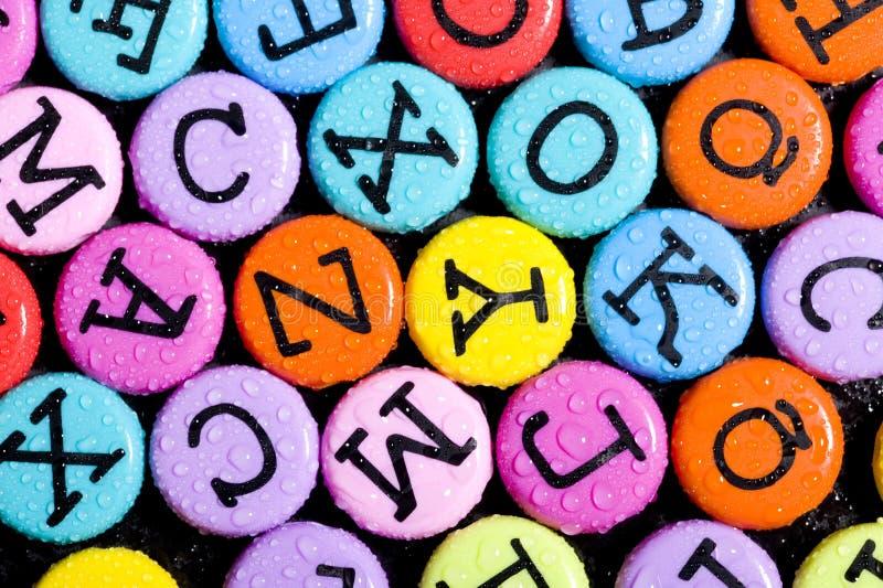字母表色的背景 免版税库存图片
