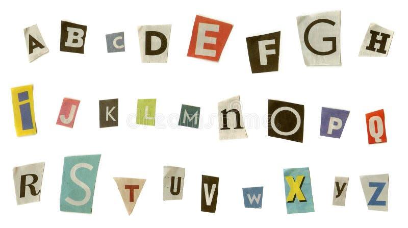 字母表从报纸切开了,隔绝在白色。 库存图片