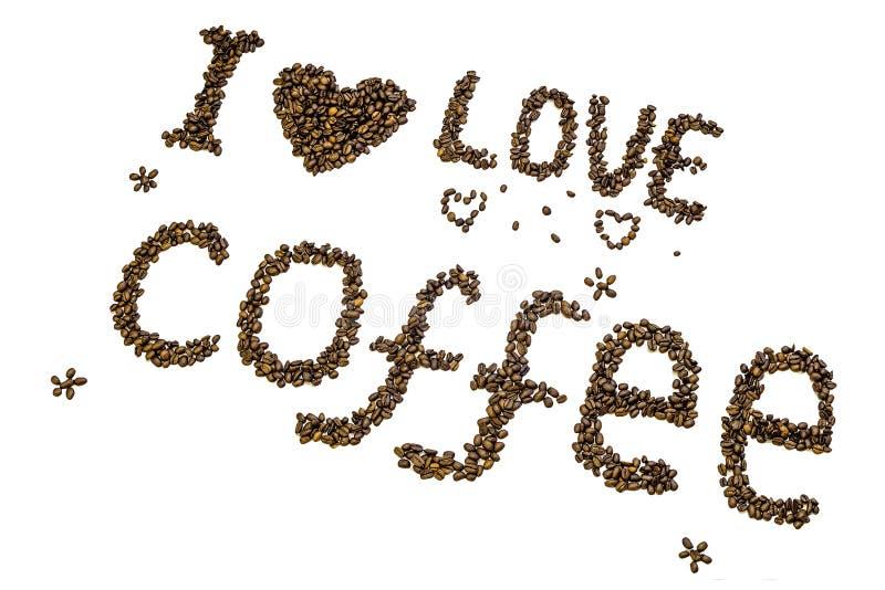 字法`我爱咖啡`由烤咖啡豆制成 库存图片