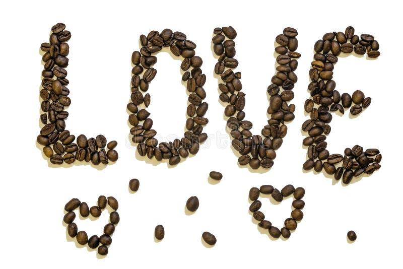 字法`爱`做烤咖啡豆 库存照片