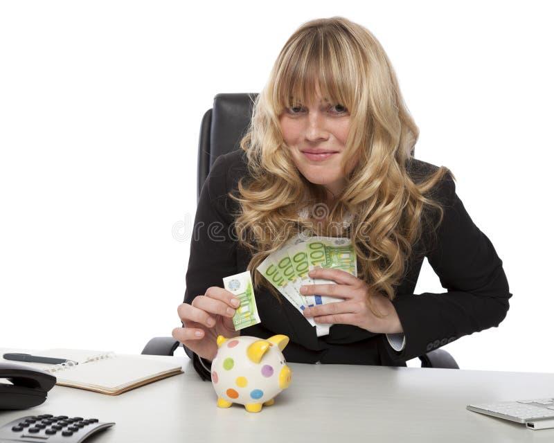 存她的金钱的成功的企业家 图库摄影