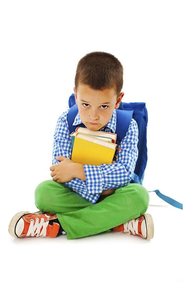 学习感到厌烦,挫败和淹没的男小学生家庭作业 免版税库存图片