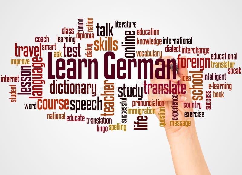 学会德国词云彩和手有标志概念的 图库摄影