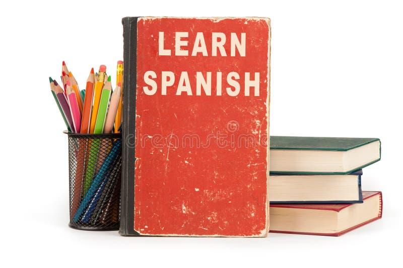 学会西班牙语 空白的学校用品 免版税库存图片