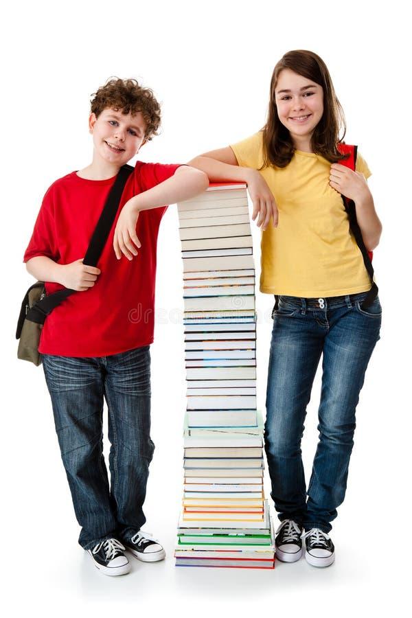 学员和堆书 免版税库存图片