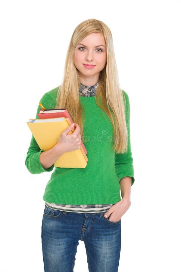 学员女孩纵向有书的 免版税库存照片