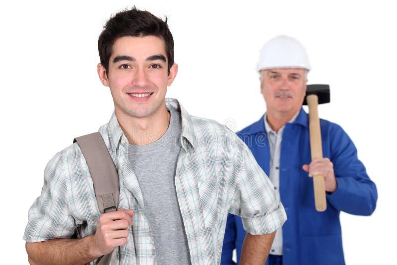 年轻学徒和泥工 免版税图库摄影