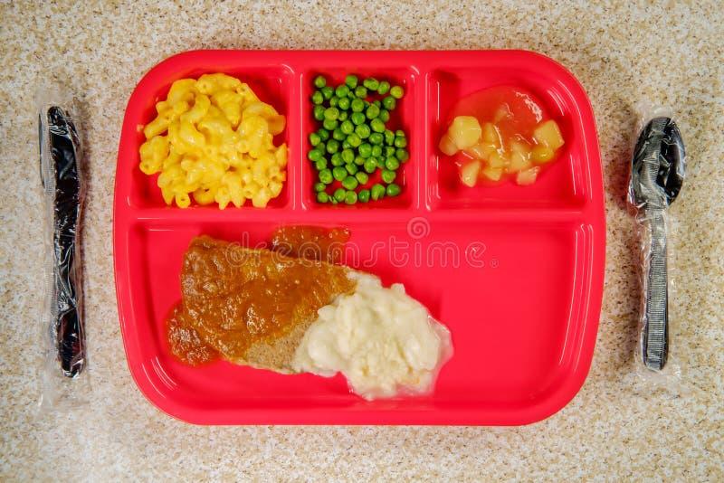 学校午餐汉堡牛排 免版税库存图片