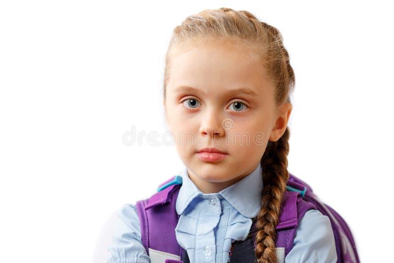 学校女孩画象,隔绝在白色 库存图片